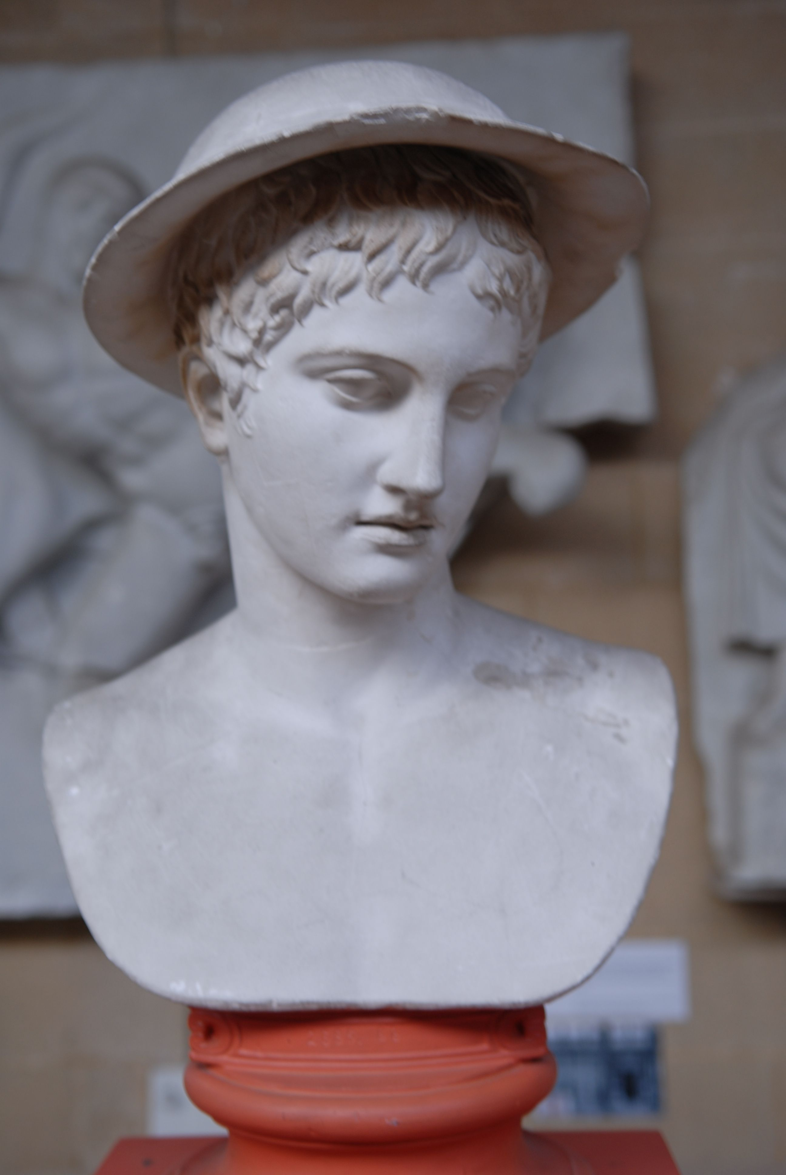 plaster cast of Hermes in a flat cap which looks like a helmet