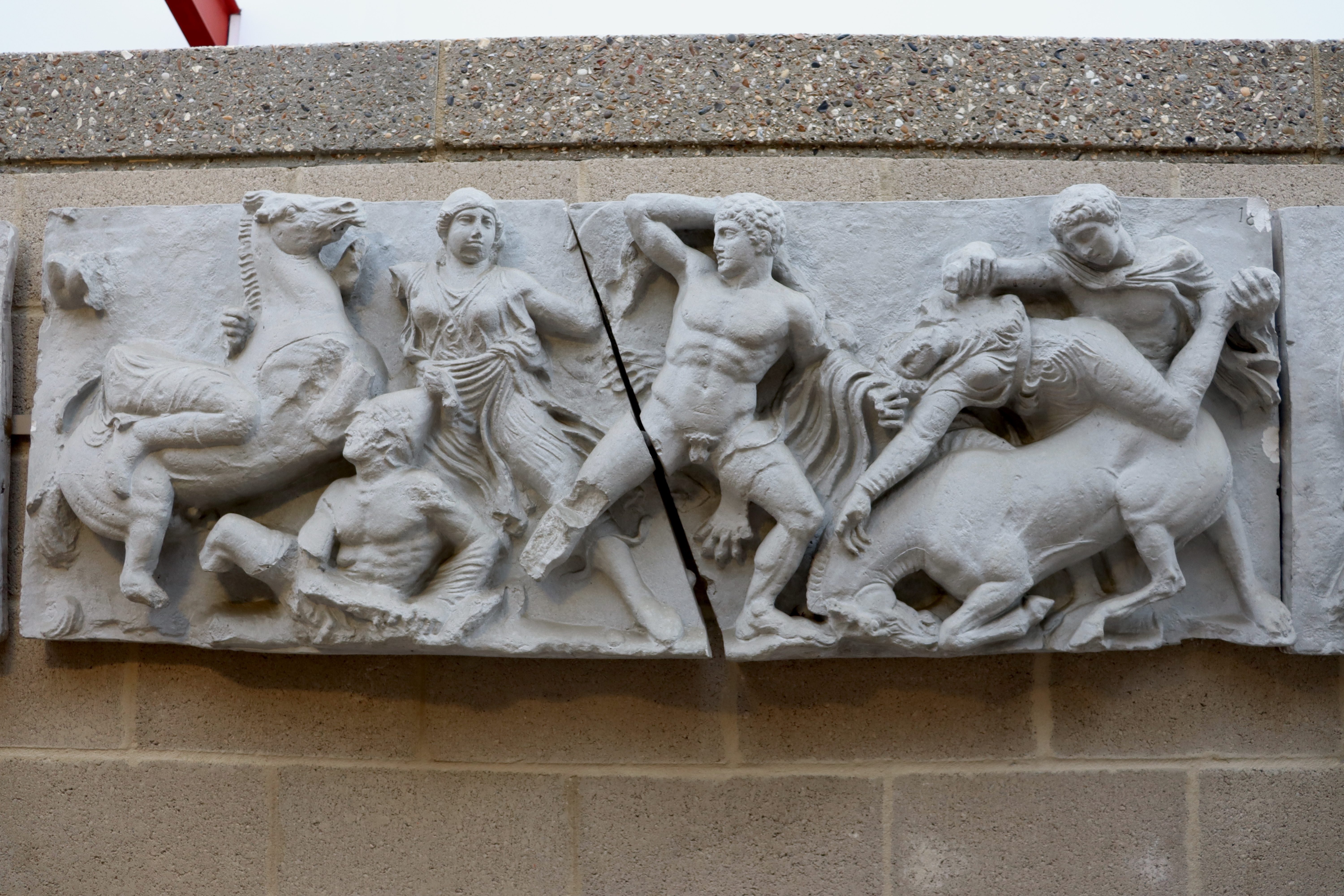 two parts of a panel from the Bassai frieze, with Hercules in the middle