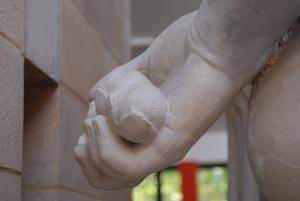 sculpted hands holding apples