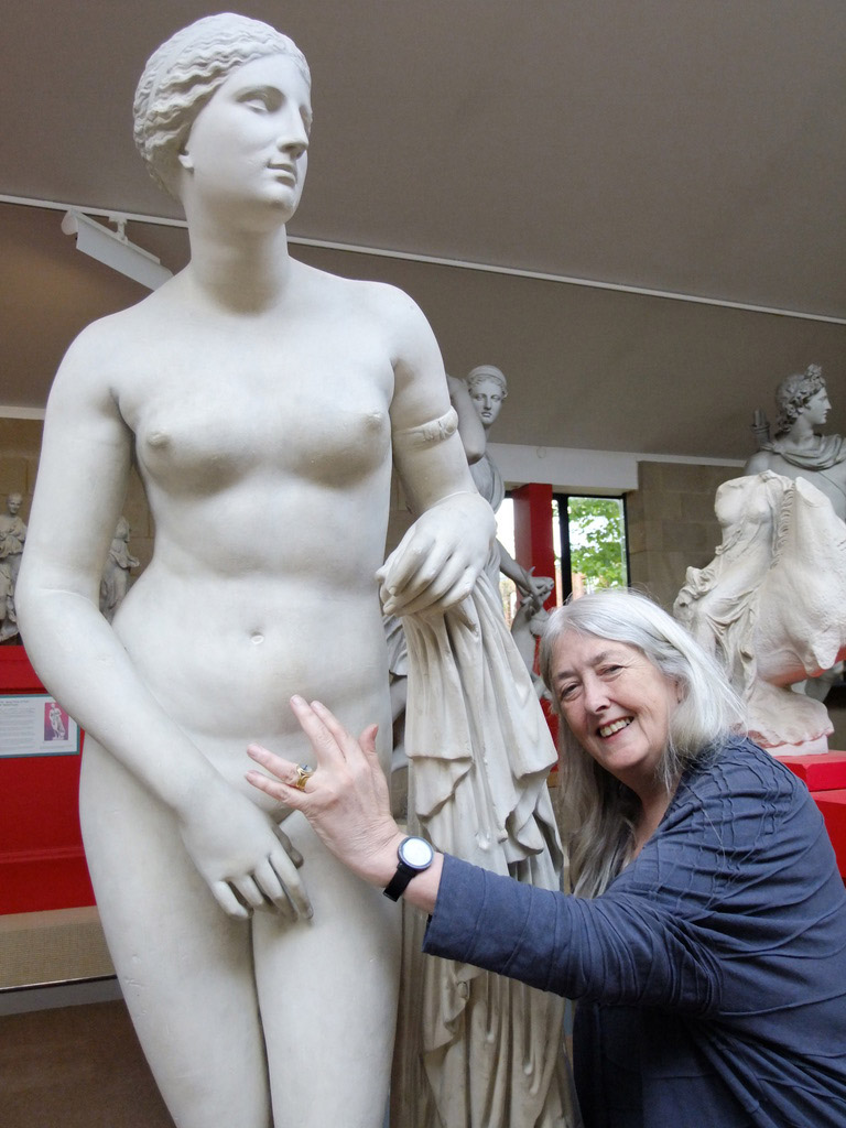 Mary Beard reaches out to statue of a naked woman