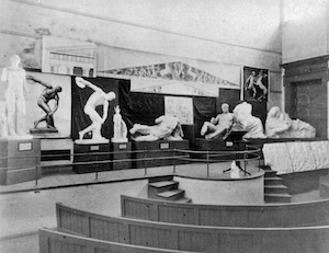 black and white image of casts on a lecture theatre stage