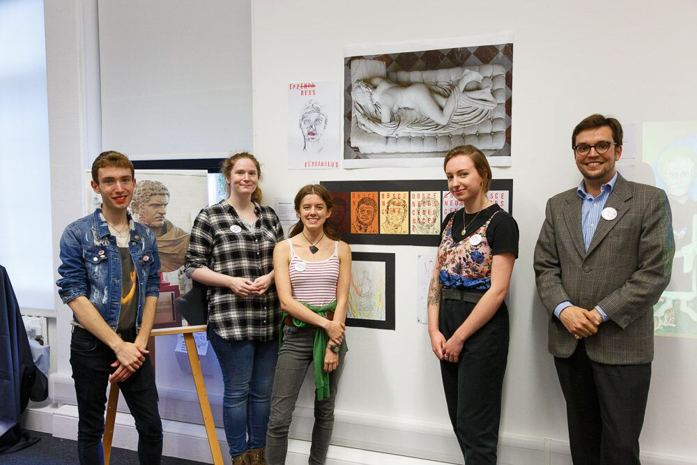 the museum remix team stand in front of their display