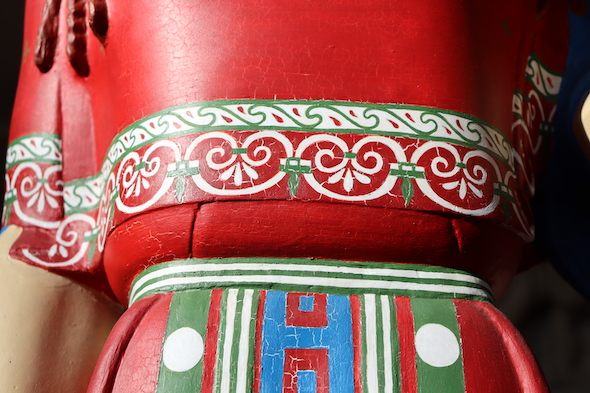 detail of painted Peplos Kore's red dress, with green, white and blue detailing