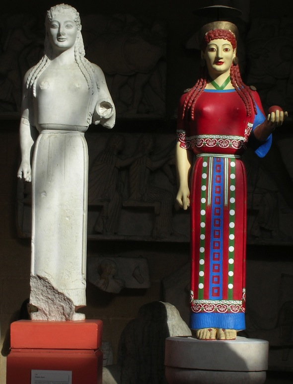 white unrestored cast of Peplos Kore next to version in red dress with blue and green details