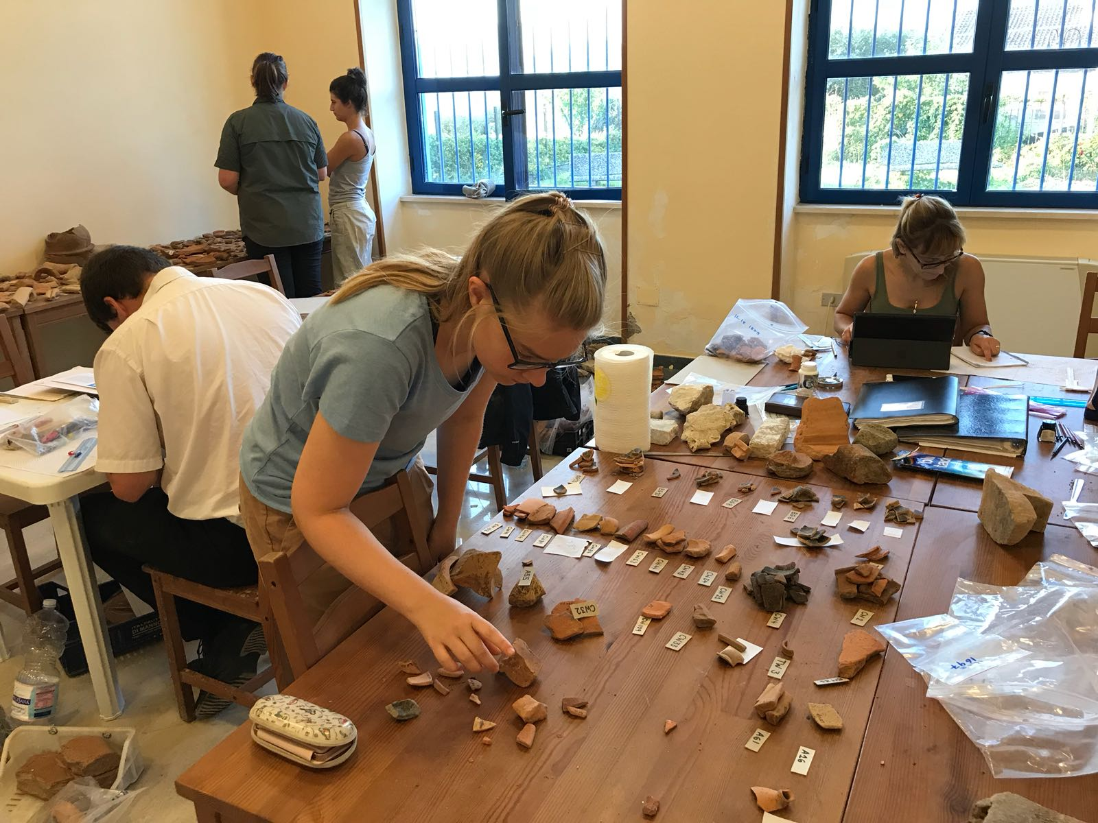 Cambridge Classics students sorting potsherds at the site of the Roman town of Interamna Lirenas