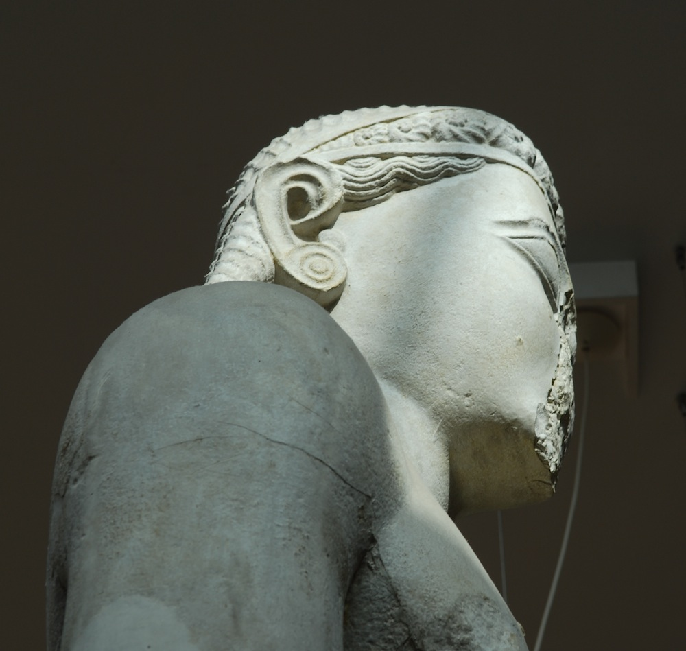 head of statue from side with braided hairstyle