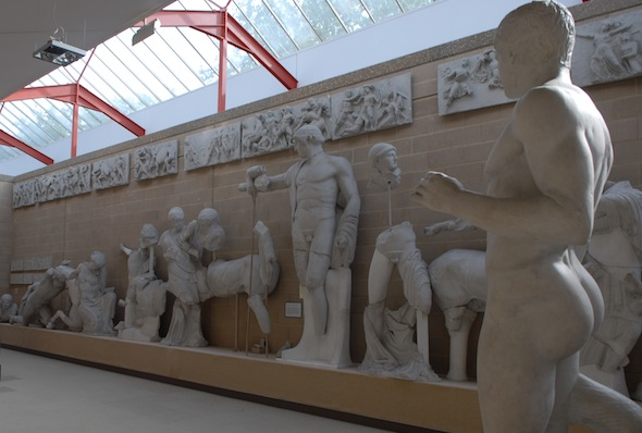 pediment with centaurs fighting men and Apollo standing tall in middle