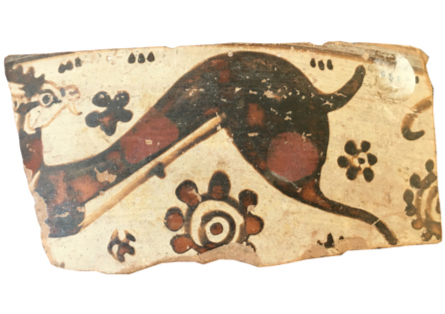 sherd of pottery with goat and flower pattern