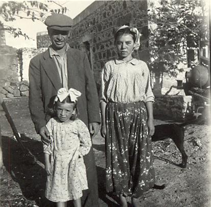 black and white photo of a local Turkish family, a man, woman and little girl with a bow in her hair