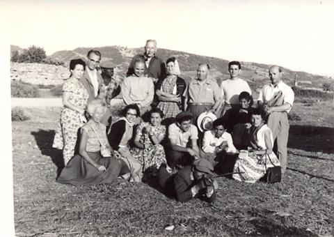 black adn white photograph of a group of men and women of different ages and ethnicities