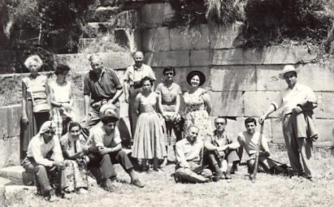 black and white photograph of a group of men and women, including local Turksih guides