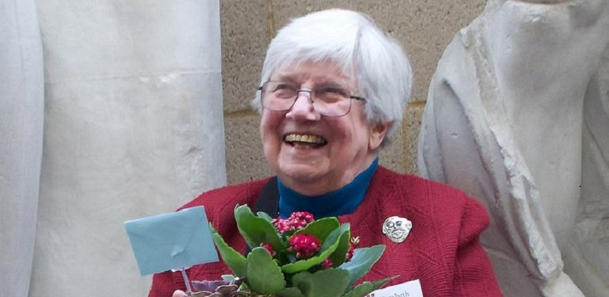 Lisa French, at her 85th birthday celebration, with flowers