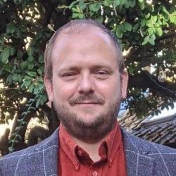 Simon P.  Flack