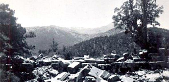 black and white photographs of ruins in front of trees and mountains