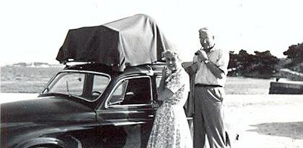 black and white photo of George Bean and his wife in front of a car