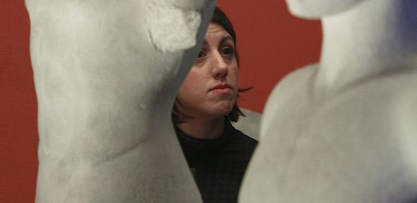 A woman looks at a cast