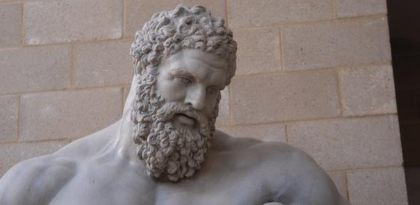 head of Hercules, looking down with curly hair and beard