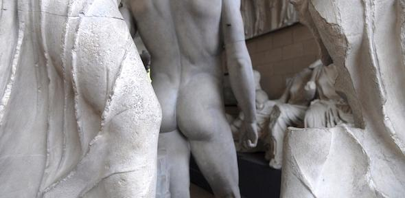 Rear of a naked male statue and Parthenon pedimental sculpture