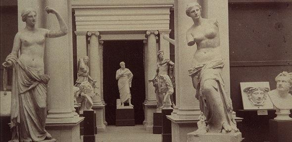 black and white photograph of plaster casts in old museum interior