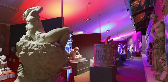 view of the Museum with bright pink and purple lights lighting up the statues