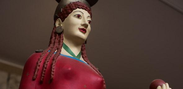 Painted face of the Peplos Kore, with red lips and eyes
