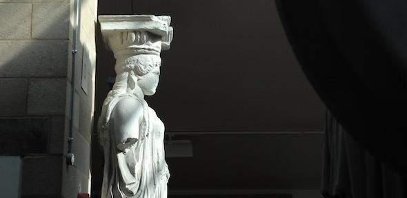 statue of a caryatid in the sunshine