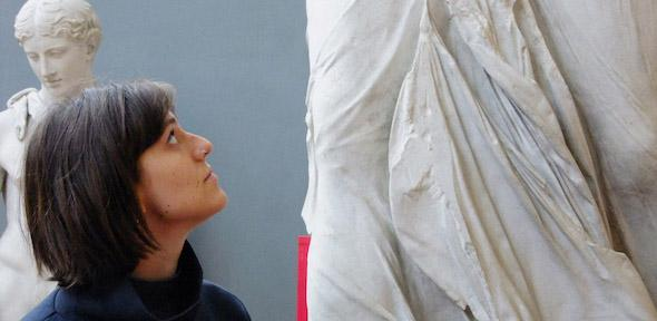 Rosy looks up at the Nike of Samothrace