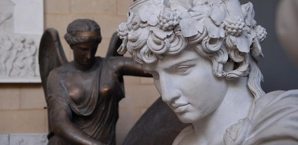 Sculpted head of Antinous, with bronzed winged Nike behind