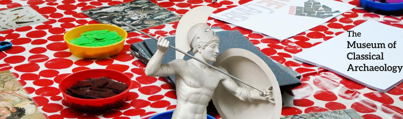 statue of Ancient Greek warrior on a red background